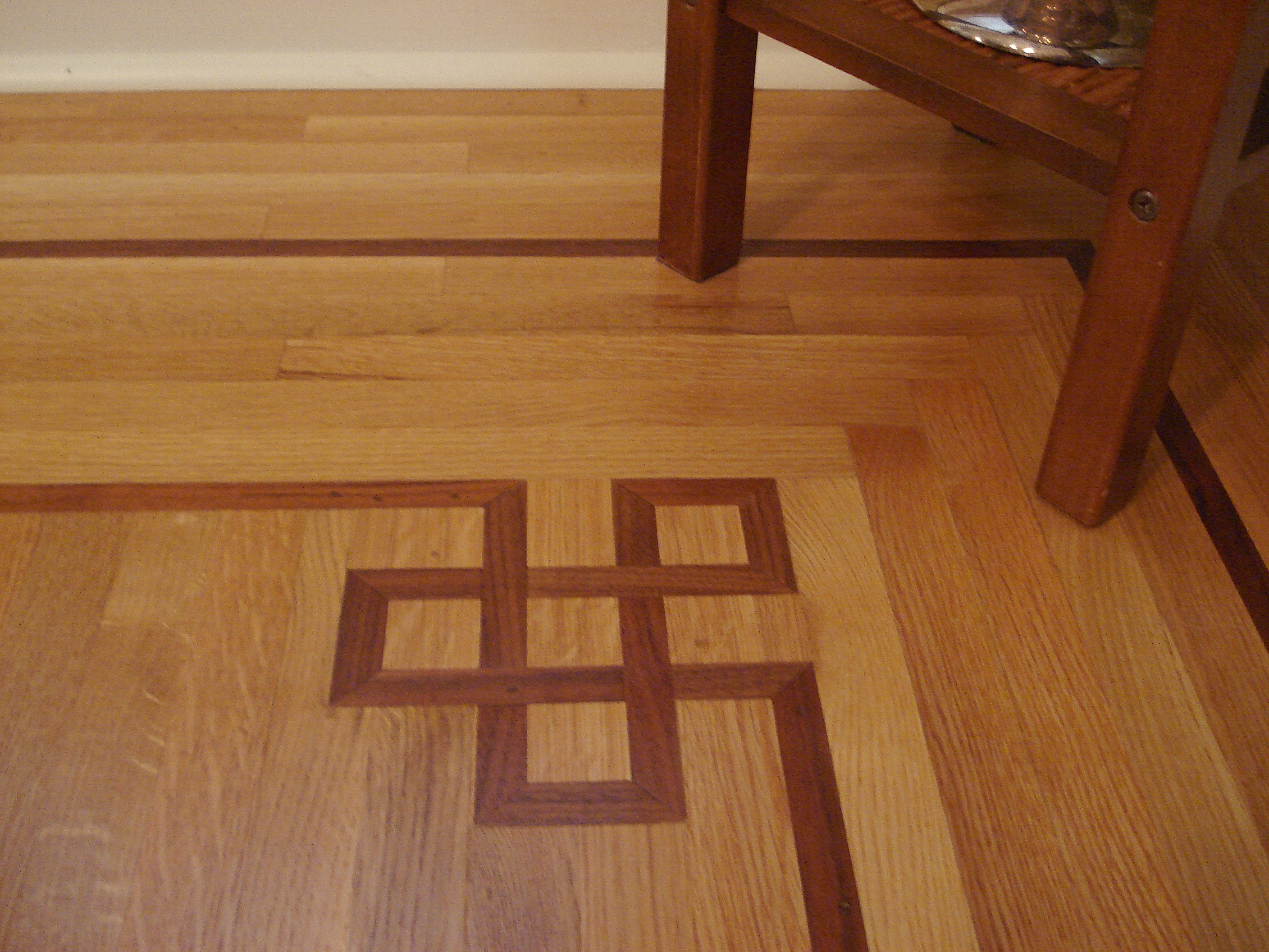 Oak flooring tampa installation by through the woods fine for Wood floor knot filler